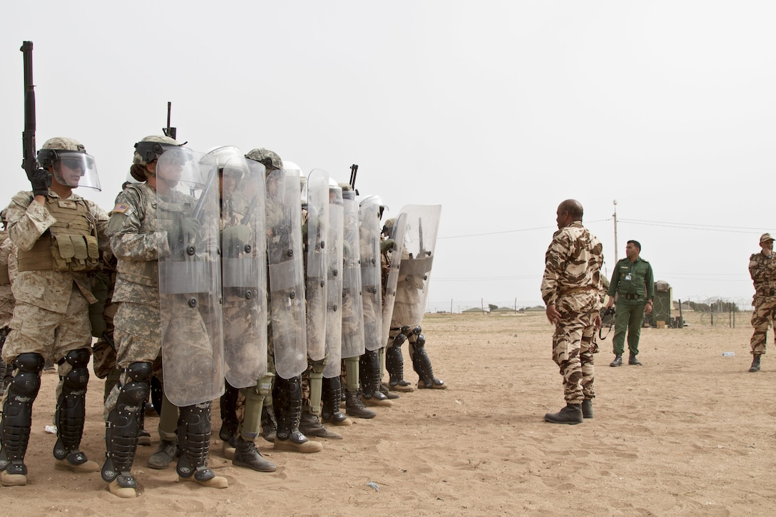 U.S. Soldiers representing the 805th Military Police Company from Cary N.C participate in crowd control training with Alpha 3rd Marine Fleet Antiterrorism Security Team (FAST) and Royal Moroccan Armed Forces during Exercise African Lion 17 April 23, at Tifnit, Morocco.Exercise African Lion is an annually scheduled, combined multilateral exercise designed to improve interoperability and mutual understanding of each nation's tactics, techniques and procedures.