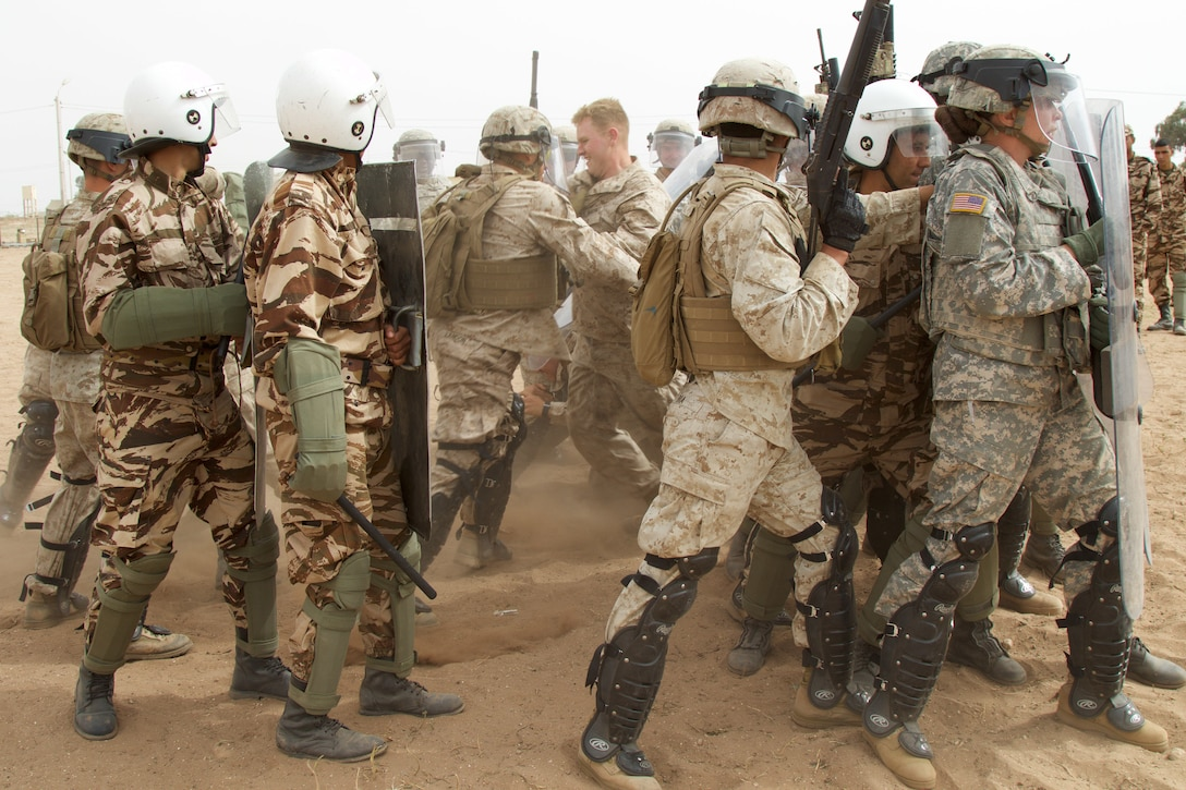 U.S. Soldiers and Marines participate in crowd control training Royal Moroccan Armed Forces during Exercise African Lion 17 April 23, at Tifnit, Morocco. Exercise African Lion is an annually scheduled, combined multilateral exercise designed to improve interoperability and mutual understanding of each nation's tactics, techniques and procedures.