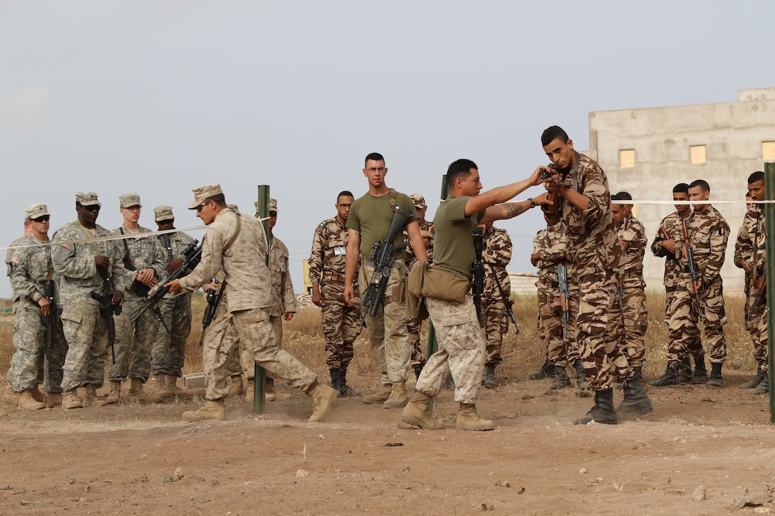 Marine close quarters battle instructors assist and observe U.S. Soldiers, Marines and Royal Moroccan Soldiers at military operations in urbanized terrain training during Exercise African Lion 17 April 24, at Tifnit, Morocco.