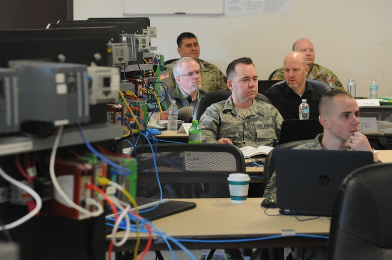 Members of the Army National Guard, Air National Guard, and U.S. Army Reserve, as well as civilians who work in law-enforcement, intelligence and information technologies, participate in the ISA CS34/CS37 62443 Cybersecurity Design Specialist/Maintenance Specialist course as part of Cyber Shield 17 at Camp Williams, Utah, April 28, 2017. Cyber Shield 17 is the sixth iteration of this training exercise and this year unites the Army National Guard with members of the Air National Guard, Army Reserve, and civilians from private companies, state government agencies, federal agencies, industry partners, and academia. (U.S. Army National Guard photo by Sgt. Michael Giles)