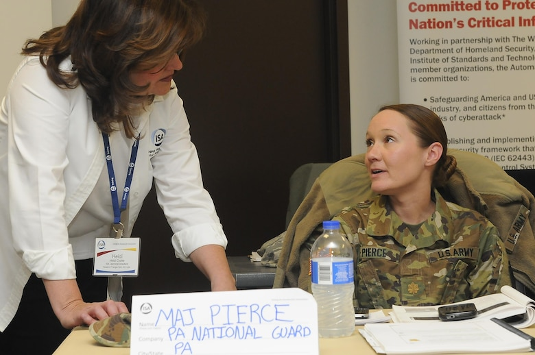 Heidi Cooke, senior learning consultant with the International Society of Automation, speaks with Maj. Christine Pierce, Pennsylvania National Guard Defensive Cyber Operations Elements team chief and participant of the ISA CS34/CS37 62443 Cybersecurity Design Specialist/Maintenance Specialist course as part of Cyber Shield 17 at Camp Williams, Utah, April 26, 2017. Cyber Shield 17 is the sixth iteration of this training exercise and this year unites the Army National Guard with members of the Air National Guard, Army Reserve, and civilians from private companies, state government agencies, federal agencies, industry partners, and academia. (U.S. Army National Guard photo by Sgt. Michael Giles)
