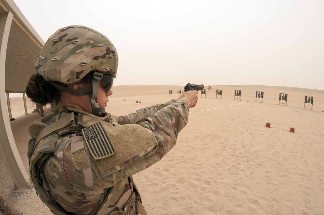 Sgt. Kelly Gary, a Public Affairs NCO with the 29th Infantry Division, fires a M9 pistol during the marksmanship portion of the German Armed Forces Badge qualification. The German Armed Forces Badge for Military Proficiency is one of the most sought after foreign awards in the United States Army. The 316th ESC and the 1st Sustainment Command (Theater) had the privilage of hosting the award qualifications at Camp Arifjan, Kuwait April 27, 2017.