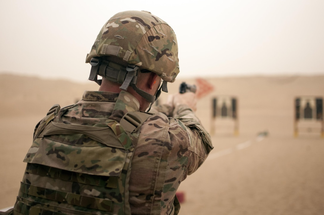 A U.S. Army Central Command Soldier fires the M9 pistol during the marksmanship portion of the German Armed Forces Badge qualification. The German Armed Forces Badge for Military Proficiency is one of the most sought after foreign awards in the United States Army. The 316th Sustainment Command (Expeditionary) and the 1st Sustainment Command (Theater) had the privilage of hosting the award qualifications at Camp Arifjan, Kuwait April 27, 2017.