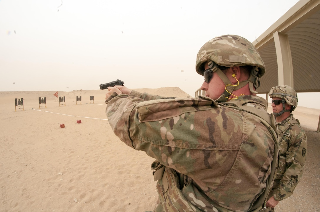 Spc. Justin Griffiths, a Cable Systems Installer-Maintainer with the 316th Sustainment Command (Expeditionary), fires a M9 pistol during the marksmanship portion of the German Armed Forces Badge qualification. The German Armed Forces Badge for Military Proficiency is one of the most sought after foreign awards in the United States Army. The 316th ESC and the 1st Sustainment Command (Theater) had the privilage of hosting the award qualifications at Camp Arifjan, Kuwait April 27, 2017.