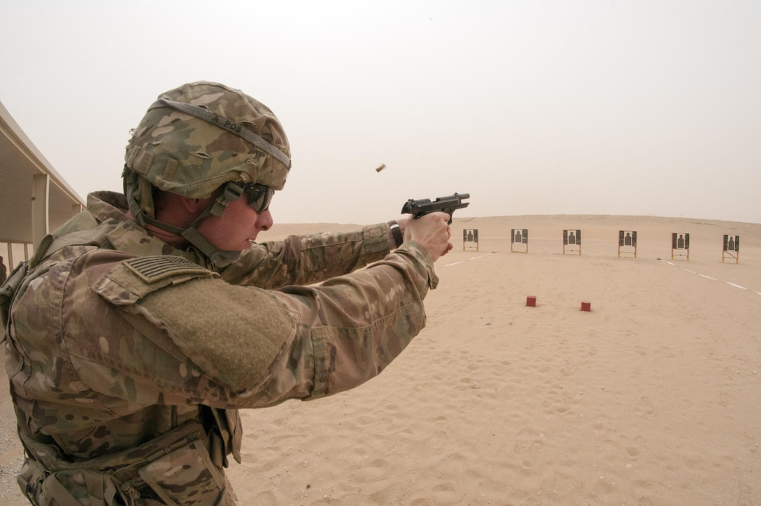1st Lt. John Gaul, a Mobility Officer with the 316th Sustainment Command (Expeditionary), fires a M9 pistol during the marksmanship portion of the German Armed Forces Badge qualification. The German Armed Forces Badge for Military Proficiency is one of the most sought after foreign awards in the United States Army. The 316th ESC and the 1st Sustainment Command (Theater) had the privilage of hosting the award qualifications at Camp Arifjan, Kuwait April 27, 2017.