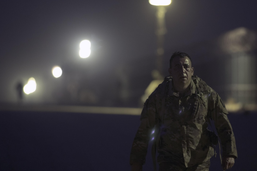 Chief Warrent Officer 3 Raul Echevarria, the property book officer with the 369th Sustainment Brigade, marches during the ruck march portion of the German Armed Forces Badge qualification. The German Armed Forces Badge for Military Proficiency is one of the most sought after foreign awards in the United States Army. The 316th ESC and the 1st Sustainment Command (Theater) had the privilage of hosting the award qualifications at Camp Arifjan, Kuwait April 27, 2017.
