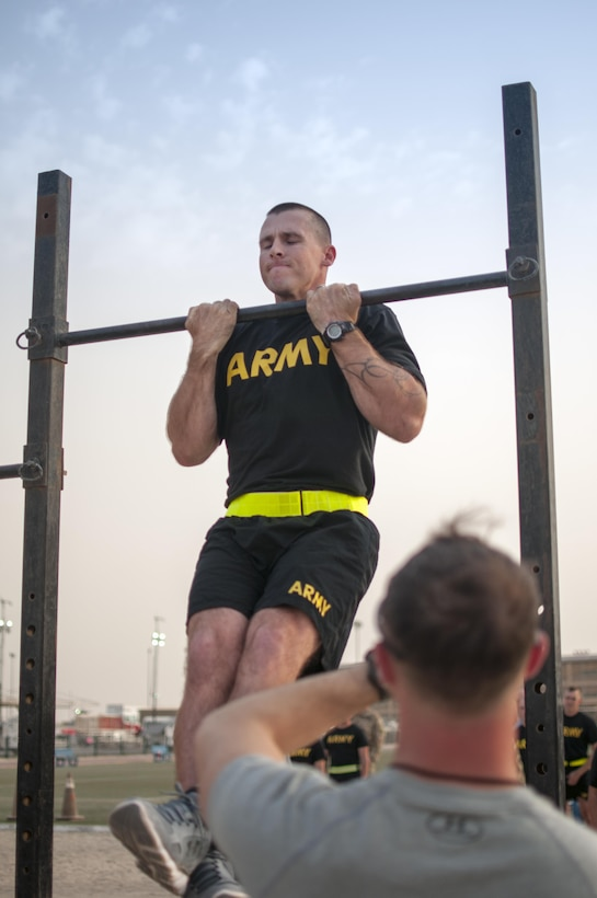 Spc. William Lloyd, a Cable Systems Installer-Maintainer with the 316th Sustainment Command (Expeditionary), participates in the flexed arm-hang during qualifications for the German Armed Forces Badge for Military Proficiency. The 316th ESC and the 1st Sustainment Command (Theater) had the privilage of hosting the award qualifications at Camp Arifjan, Kuwait April 27, 2017.