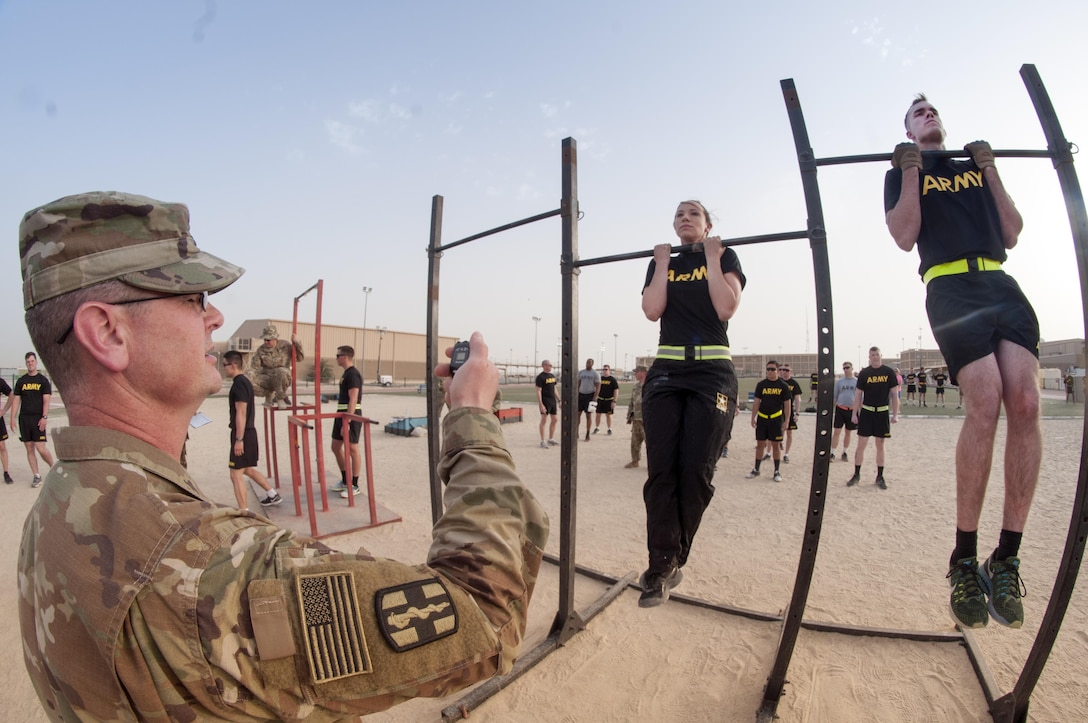 Soldiers from Commands throughout CENTCOM participate in the flexed arm-hang during qualifications for the German Armed Forces Badge for Military Proficiency. The 316th ESC and the 1st Sustainment Command (Theater) had the privilage of hosting the award qualifications at Camp Arifjan, Kuwait April 27, 2017.