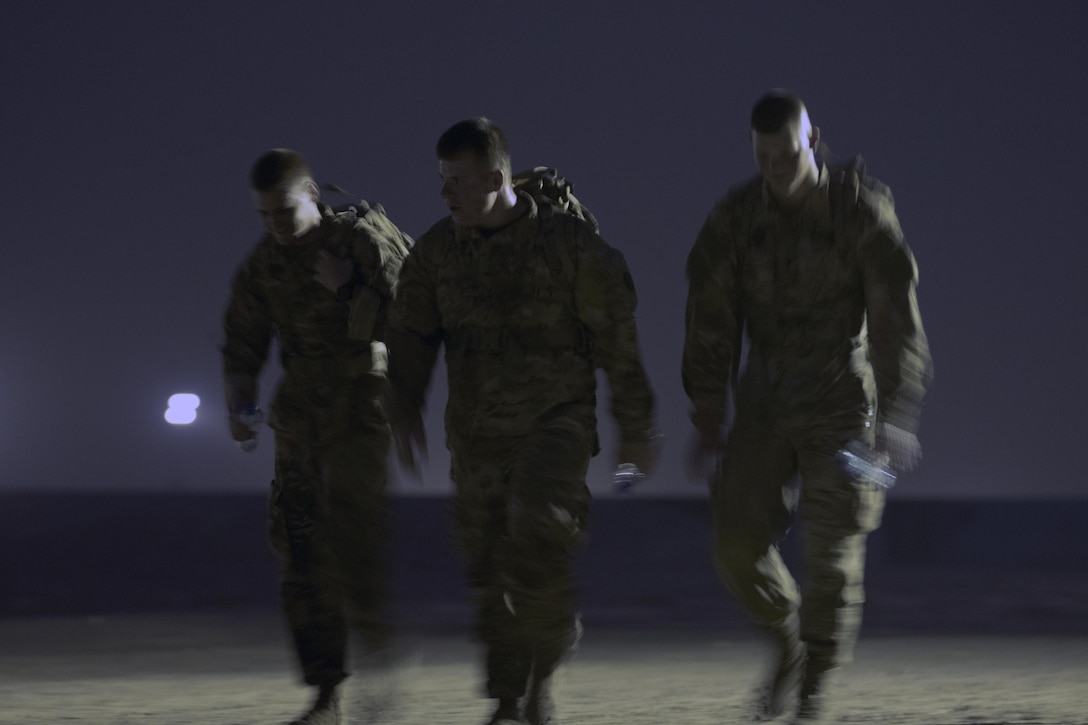 Soldiers ruck during the ruck-march portion of the German Armed Forces Badge qualification. The German Armed Forces Badge for Military Proficiency is one of the most sought after foreign awards in the United States Army. The 316th ESC and the 1st Sustainment Command (Theater) had the privilage of hosting the award qualifications at Camp Arifjan, Kuwait April 27, 2017.