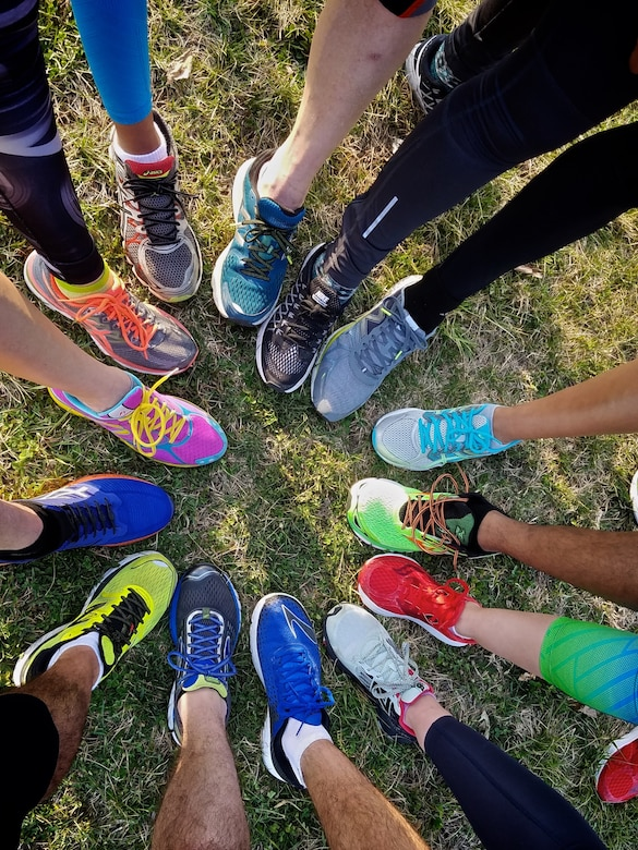 Scott Health Promotion Running Clinic group leader's show off their running shoes, March 8, 2017, Scott Air Force Base, Illinois. (U.S. Air Force photo by Christopher Parr)