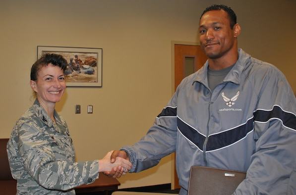 U.S. Air Force Col. Donna Turner, commander of the Air Force Services Activity, greets Capt. David Simon, after he was selected as an Air Force World Class Athlete Program bobsled pusher in August 2016. Simon is still aiming for a spot on the U.S. Bobsled Team that will compete in the 2018 Winter Olympics in Peyongchang, Republic of Korea. (U.S. Air Force photo by Carole Chiles Fuller)