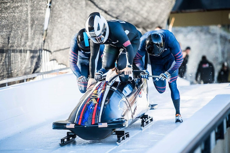 U.S. Air Force Capt. David Simon (right) pushes the bobsled before hopping in for a run at the U.S.Bobsled Team Trials in Park City, Utah, on Nov. 2, 2016. (Courtesy photo)