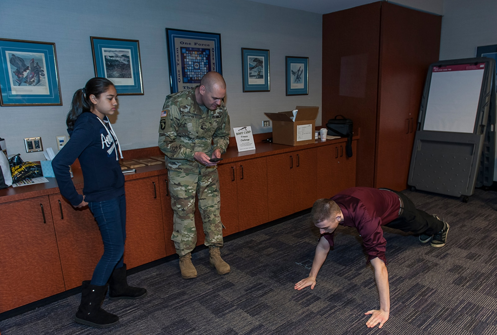 Matthew Rush, 16, performs pushups during the Fitness Challenge at DSCC's 'Take our daughters and sons to work day'. Rush was one of more than 100 children aged 9-17 who attended the April 27 event aimed at educating children about the contributions their parents and guardians make to warfighter support.