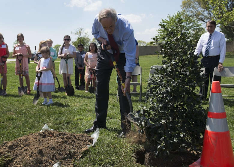 Sen. Tom Carper, Del., shovels dirt to plant a tree at the State of Delaware Arbor Day event April 28, 2017, at Dover Air Force Base, Del. The tree is an American Holly, the official state tree of Delaware. (U.S. Air Force photo by Senior Airman Zachary Cacicia)