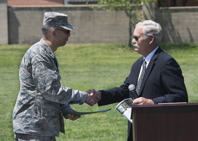 Col. Randy Boswell, 436th Mission Support Group commander, accepts the Tree City USA 25 Year certificate from Delaware Secretary of Agriculture Michael Scuse April 28, 2017, at Dover Air Force Base, Del. Boswell accepted the certificate on behalf of Dover AFB. (U.S. Air Force photo by Senior Airman Zachary Cacicia)