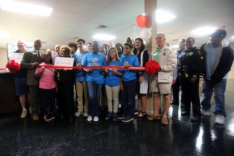 Local members of the community gather during a Boys & Girls Club opening at New Bern, N.C., April 24, 2017. Marines assigned to Marine Wing Support Squadron 272, Marine Aircraft Group 26, 2nd Marine Air Wing joined the local community for the reveal of the youth center after it was constructed from the remains of an old nightclub. The work the Marines accomplished made it possible to jump start the project. (U.S. Marine Corps photo by Sgt. N.W. Huertas/Released)