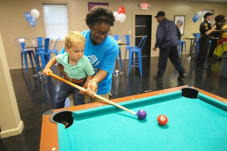 Children enjoy their new facilities during a Boys & Girls Club opening at New Bern, N.C., April 24, 2017. Marines assigned to Marine Wing Support Squadron 272, Marine Aircraft Group 26, 2nd Marine Air Wing joined the local community for the reveal of the youth center after it was constructed from the remains of an old nightclub. 13 Marines assigned to the squadron volunteered for the construction of the facility. (U.S. Marine Corps photo by Sgt. N.W. Huertas/Released)