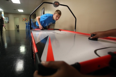 Children play games in their new facilities during a Boys & Girls Club opening at New Bern, N.C., April 24, 2017. Marines assigned to Marine Wing Support Squadron 272, Marine Aircraft Group 26, 2nd Marine Air Wing joined the local community for the reveal of the youth center after it was constructed from the remains of an old nightclub. 13 Marines assigned to the squadron volunteered for the construction of the facility. (U.S. Marine Corps photo by Sgt. N.W. Huertas/Released)