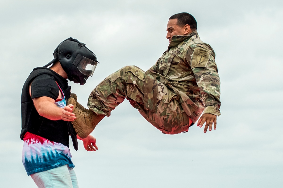 A soldier demonstrates combat techniques on a volunteer.