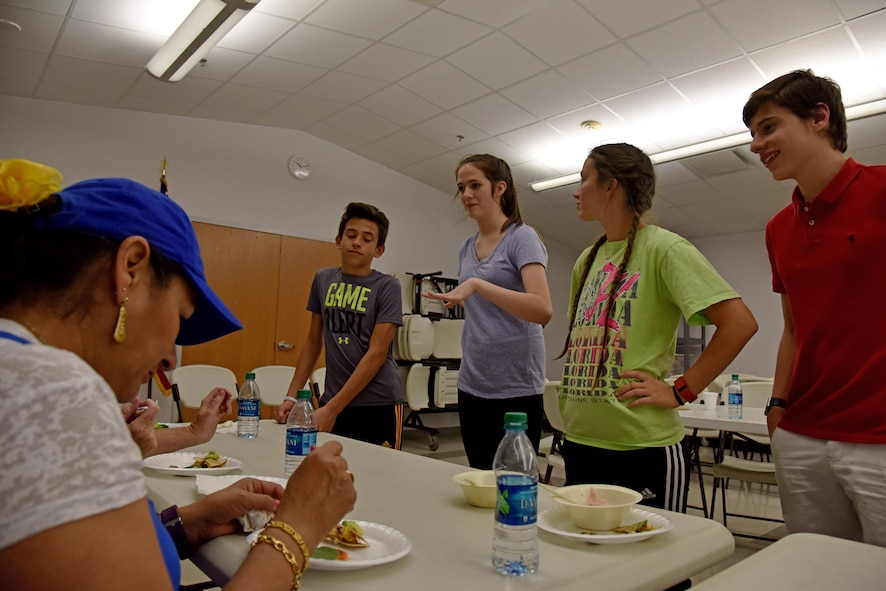 A Teen Cook Challenge team presents their food to judges at the Taylor Chapel on Goodfellow Air Force Base, Texas, April 28, 2017. Judges scored the food on taste, presentation and how healthy it was. (U.S. Air Force photo by Staff Sgt. Joshua Edwards/Released)