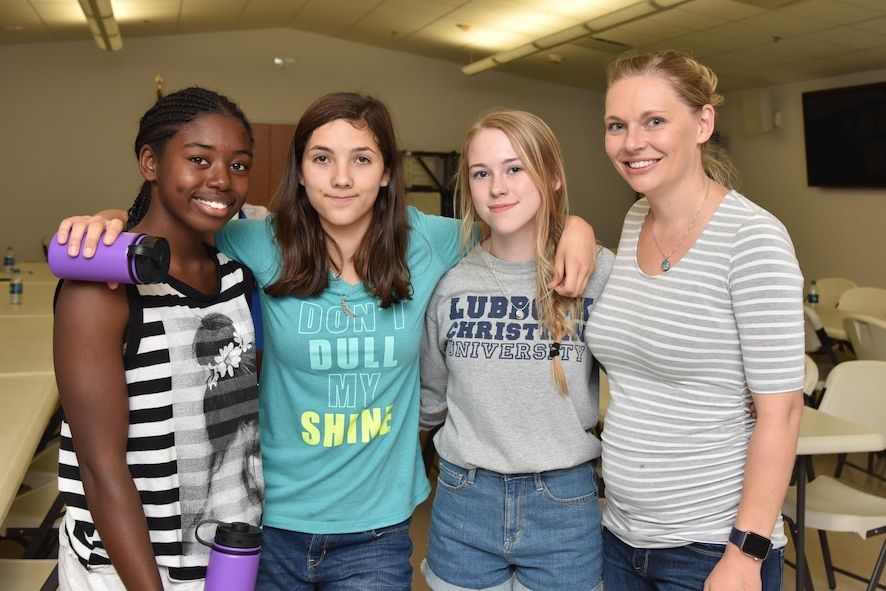 (Left) Ki Wilburn, Lizzy Maldonado, and Ashtyn Reed pose with Elizabeth Burmeister, 17th Medical Operations Squadron health promotion coordinator, during Teen Chef Challenge at the Taylor Chapel on Goodfellow Air Force Base, Texas, April 28, 2017. Burmeister held the contest to teach teens about healthy eating and portion control.  (U.S. Air Force photo by Staff Sgt. Joshua Edwards/Released)