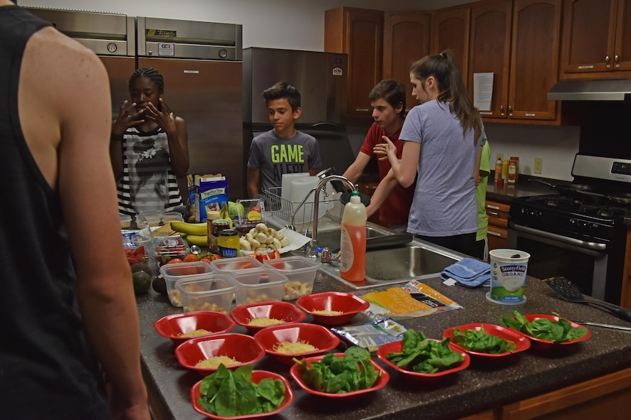Teen Chef Challenge contestants picked out their ingredients at the Taylor Chapel on Goodfellow Air Force Base, Texas, April 28, 2017. The goal of the contests was to teach the teens to make a healthy choices. (U.S. Air Force photo by Staff Sgt. Joshua Edwards/Released)
