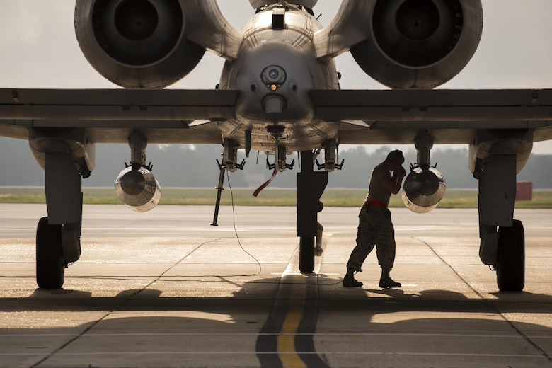 A crew chief from the 75th Aircraft Maintence Unit secures a travel pod during a pre-flight inspection on an A-10C Thunderbolt II, April 28, 2017 at Moody Air Force Base. The 75th FS departed for Combat Hammer, an air-to-ground exercise hosted at Hill Air Force Base, Utah. The exercise is designed to collect and analyze data on the performance of precision weapons and measure their suitability for use in combat. (U.S. Air Force photo by Andrea Jenkins)