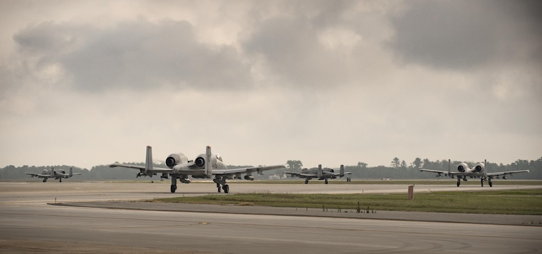 A-10C Thunderbolt II aircraft taxi down the runway, April 28, 2017 at Moody Air Force Base. The 75th FS departed for Combat Hammer, an air-to-ground exercise hosted at Hill Air Force Base, Utah. The exercise is designed to collect and analyze data on the performance of precision weapons and measure their suitability for use in combat. (U.S. Air Force photo by Andrea Jenkins)