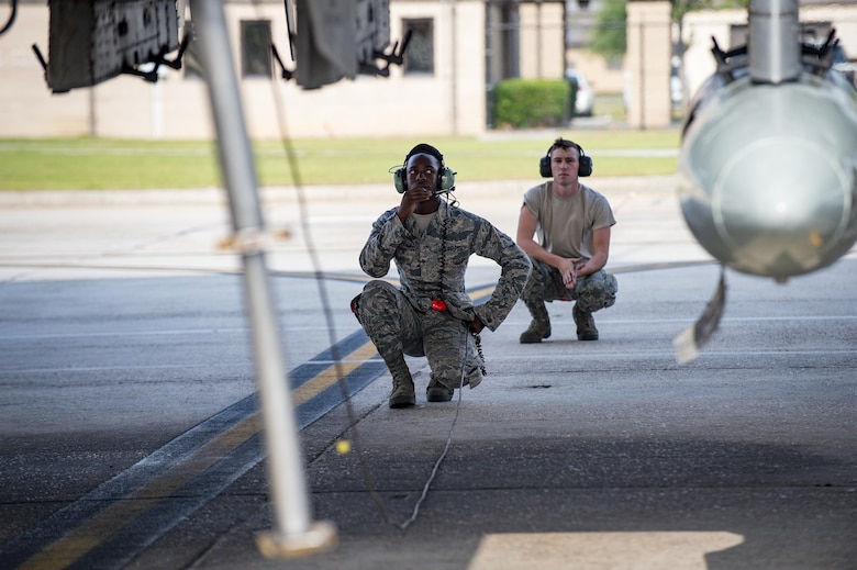Crew chiefs with the 75th Aircraft Maintenance Unit preform preflight inspections, April 28, 2017, at Moody Air Force Base, Ga. The 75th FS departed for Combat Hammer, an air-to-ground exercise hosted at Hill Air Force Base, Utah. The exercise is designed to collect and analyze data on the performance of precision weapons and measure their suitability for use in combat. (U.S. Air Force photo by Andrea Jenkins)
