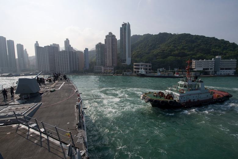 A harbor tug guides the Arleigh Burke-class guided-missile destroyer USS Sterett (DDG 104) as the ship prepares to moor in Hong Kong for a scheduled port visit, April 29, 2017. Sterett is part of the Sterett-Dewey Surface Action Group and is the third deploying group operating under the command and control construct called 3rd Fleet Forward. U.S. 3rd Fleet operating forward offers additional options to the Pacific Fleet commander by leveraging the capabilities of 3rd and 7th Fleets.