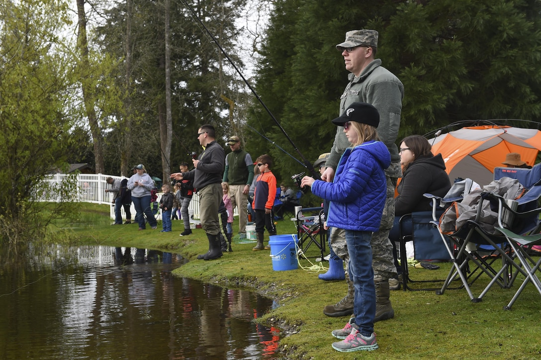 Children and their families fish during this year's Annual McChord Field Top III Fishing Derby April 29, 2017, at Carter Lake on Joint Base Lewis-McChord, Wash. For this year's event, trophies were given out for the heaviest, longest and smallest fish, for each age group. (U.S. Air Force Photo/ Staff Sgt. Naomi Shipley)