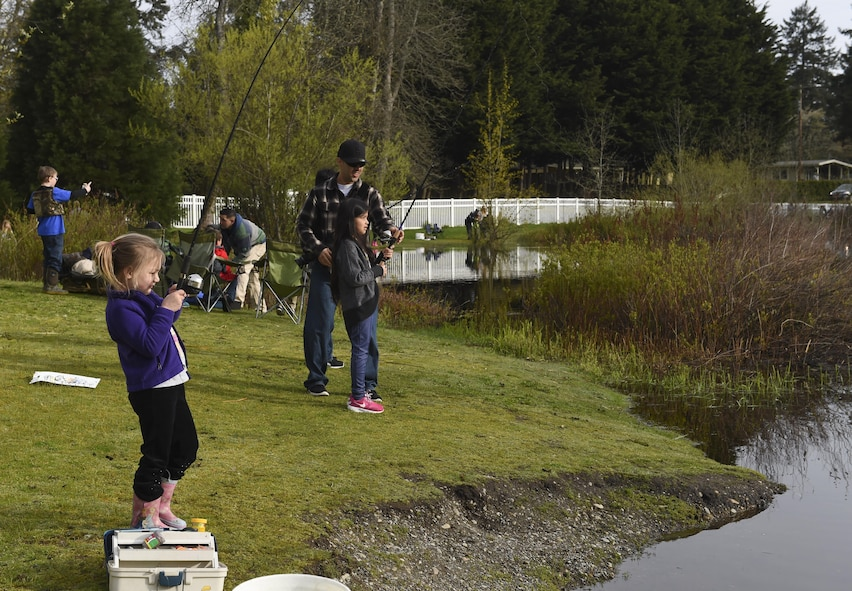 Children and their families fish during this year's Annual McChord Field Top III Fishing Derby April 29, 2017, at Carter Lake on Joint Base Lewis-McChord, Wash. The Washington Department of Fish and Wildlife provided more than 1,500 fish to make this fishing derby possible. (U.S. Air Force Photo/ Staff Sgt. Naomi Shipley)