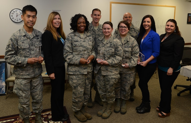 Volunteer victim advocates and representatives from the McChord Field Sexual Assault Prevention and Response office pose for a photo with 62nd Airlift Wing leadership, April 27, 2017, at Joint Base Lewis-McChord, Wash. Leadership honored six victim advocates for volunteering more than 4,000 collective hours to helping Airmen (U.S. Air Force photo/Senior Airman Jacob Jimenez).