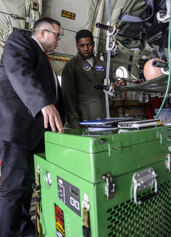 Staff Sgt. Johnathan Jeffery, 86th Aeromedical Evacuation Squadron aeromedical evacuation technician, discusses the oxygen regulator they use on flights with a local national medical provider during a tour on Ramstein Air Base, Germany, April 27, 2017. The biennial tour is designed to show medical providers from the Kaiserslautern Military Community the services the 86th AES and 86th Medical Group provide as well as where the military's care ends and their care begins. (U.S. Air Force photo/Staff Sgt. Timothy Moore)