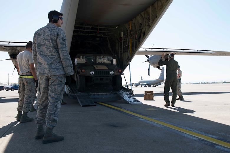 U.S. Airmen assigned to the 728th Air Mobility Squadron and 37th Airlift Squadron, unload Humvees from a U.S. Air Force C-130J Super Hercules April 26, 2017, at Incirlik Air Base, Turkey. The Humvees were delivered to Incirlik to bolster the 39th Security Forces Squadron's capabilities on the flightline. (U.S. Air Force photo by Airman 1st Class Devin M. Rumbaugh)