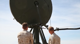 Sgt. Matthew George, left, and Cpl. Austin Hardin inspect the dish of the Tropospheric Scatter Microwave Radio Terminal, or the AN/TRC-170, during the Weapons and Tactics Instructor Course 2-17 near Marine Corps Air Station Yuma, Ariz., April 26, 2017. The AN/TRC-170 has been utilized by the Marine Corps since the 1980's and is used to transmit data, internet, phone and emails to a point target within 100 nautical miles. George and Hardin are both AN/TRC-170 operators assigned to Marine Wing Communications Squadron 28, Marine Air Control Group 28, 2nd Marine Aircraft Wing.