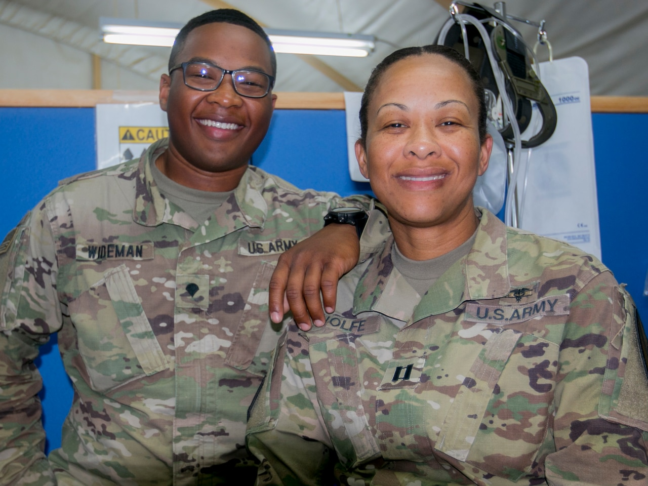 Army Capt. Andrea Wolfe, senior brigade physician assistant, and her son, Army Spc. Kameron Wideman, a behavioral health technician, both assigned to the Brigade Support Medical Company, 215th Brigade Support Battalion, are deployed for nine months to Camp Buehring, Kuwait. Army photo by Staff Sgt. Leah R. Kilpatrick