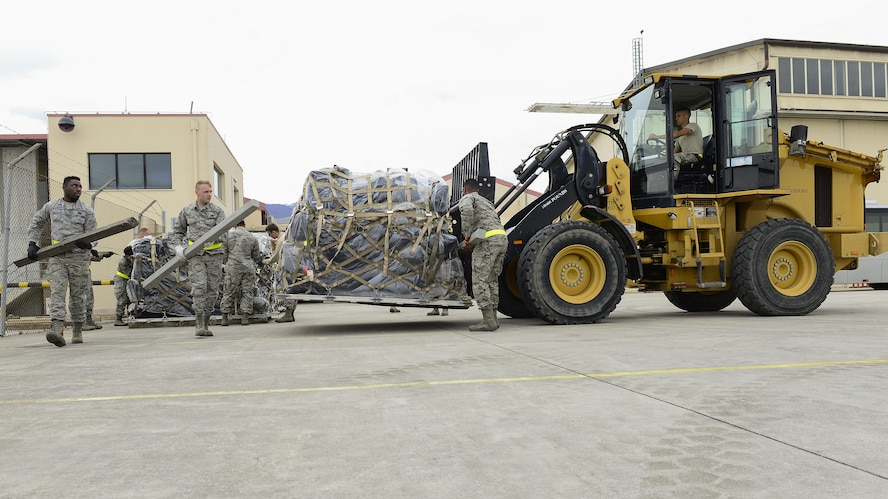 Airmen from the 31st Logistics Readiness Squadron move cargo with a 10K All-Terrain Forklift at Aviano Air Base, Italy, April 19, 2017. The 31st LRS assisted in deploying 344 service members from Aviano Air Base to Bagram Airfield. (U.S. Air Force photo by Airman 1st Class Ryan Brooks)