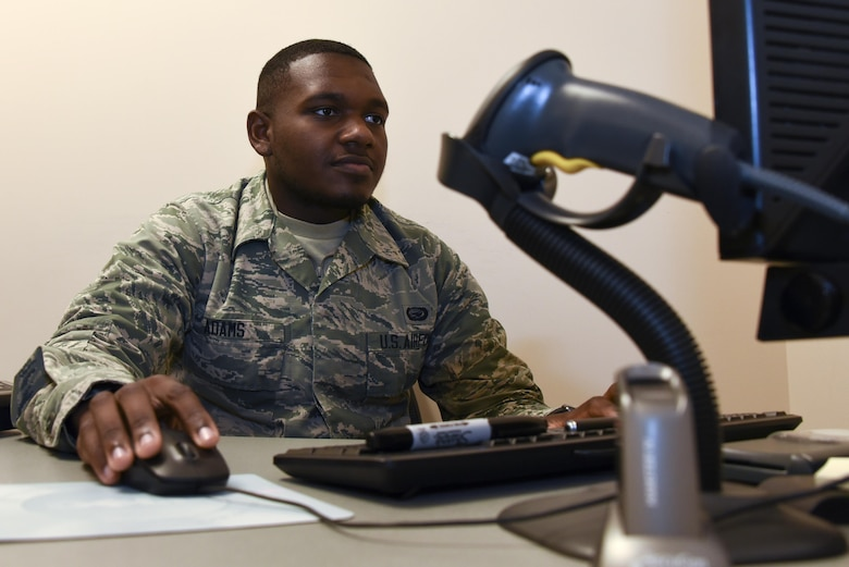 AB Avery Adams prepares to issue a common access card April 27, 2017 at Warfield Air National Guard Base, Middle River, Md. Adams is the May 2017 Spotlight Airman. (U.S. Air National Guard photo by SrA Enjoli Saunders/RELEASED)