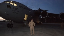 U.S. Air Force Maj. Robert Riggs, U.S. Marine Corps Forces, Special Operations Command air mobility liaison officer, prepares for his C-17 mission on the flight line at Marine Corps Air Station Cherry Point, North Carolina. Riggs drove down to Charleston, S.C., to operate the C-17 scheduled to deploy a Marine Special Operations Company to Africa and bring back a separate MSOC. The total flight took four days and visited four different countries on three continents.