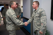 Air Force Chief of Staff Gen. David L. Goldfein recognizes 1st Lt. Jacob Myers, 45th Operations Group, for his accomplishments following a tour of the Morrell Operations Center, April 30, 2017, at Cape Canaveral Air Force Station, Fla. The tour included a brief by members of the 1st Range Operations Squadron, as well as a visit to the 45th Weather Squadron and the mission control room where he received and up-close and personal look at the space and launch mission at the 45th Space Wing. (U.S. Air Force photo/Matthew Jurgens)