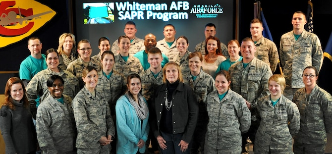 Members of the 509th Bomb Wing Sexual Assault Prevention and Response (SAPR) program pose for a group photo at Whiteman Air Force Base, Mo., Jan. 7, 2015. The Whiteman AFB SAPR program recently won the Air Force Global Strike Command SAPR Program of the Year award for the second year in a row. They are currently competing at the Air Force level.