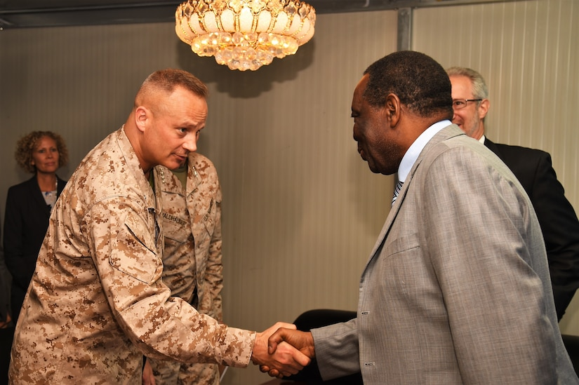 Marine Corps Brig. Gen. David J. Furness, commander of Combined Joint Task Force Horn of Africa, and Ambassador Francisco Caetano Jose Madeira, the special representative of the chairperson of the African Union Commission for Somalia, exchange greetings before their meeting at Mogadishu International Airport, Somalia, April 29, 2017. Air National Guard photo by Tech. Sgt. Andria Allmond