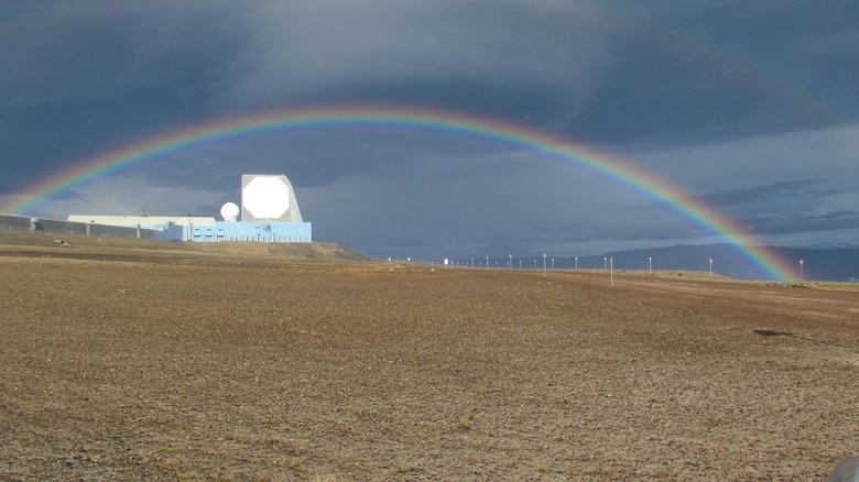 A rainbow arches above the phased-array radar system at Ballistic Missile Early Warning System – I, at Thule Air Base, Greenland. The site is operated by the 12th Space Warning Squadron, a geographically separated unit of the 21st Space Wing at Peterson Air Force Base, Colo. The Air Force Life Cycle Management Center, Hanscom Air Force Base, Mass., awarded a $40 million contract Dec., 2016 to Raytheon Integrated Defense Systems to upgrade hardware and software at the site. (Courtesy Photo)