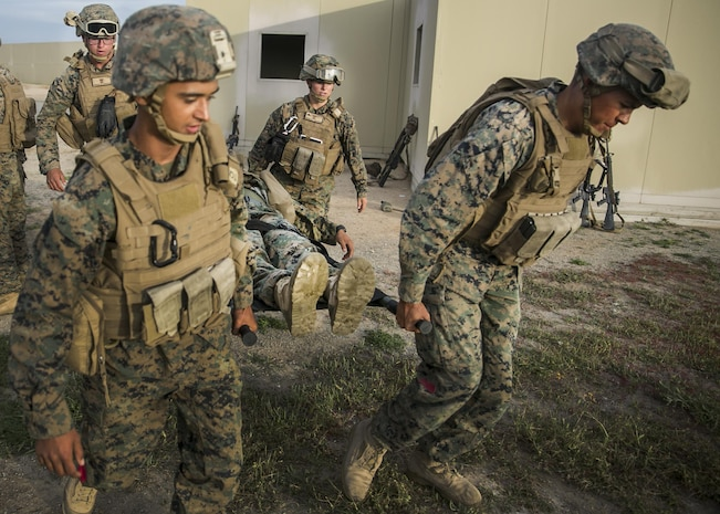 MARINE CORPS BASE CAMP PENDLETON, Calif., Marines with the Combat Battalion 15, 15th Marine Expeditionary Unit carry a notional wounded Marine in a litter bearer during a combat life saver course part PHIBRON-MEU integration training at Camp Pendleton, April 6, 2017. This first at-sea exercise provides the Marines the opportunity to practice integrating with their Navy counterparts to form an efficient team capable of accomplishing a range of missions around the globe. This Navy-Marine Corps team supports combatant commanders in maintaining regional maritime security and stability while providing offshore options to deter influence and win in an era of uncertainty. (U.S. Marine Corps photo by Cpl. Frank Cordoba)