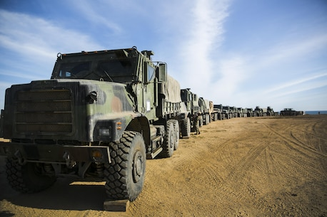MARINE CORPS BASE CAMP PENDLETON, Calif. – Marines with Combat Logistics Battalion 15, 15th Marine Expeditionary Unit line up seven-ton trucks before conducting convoy rehearsals during PHIBRON-MEU integration training at Camp Pendleton, April 8, 2017. This first at-sea exercise provides the Marines the opportunity to practice integrating with their Navy counterparts to form an efficient team capable of accomplishing a range of missions around the globe. This Navy-Marine Corps team supports combatant commanders in maintaining regional maritime security and stability while providing offshore options to deter influence and win in an era of uncertainty.   (U.S. Marine Corps photo by Cpl. Frank Cordoba)