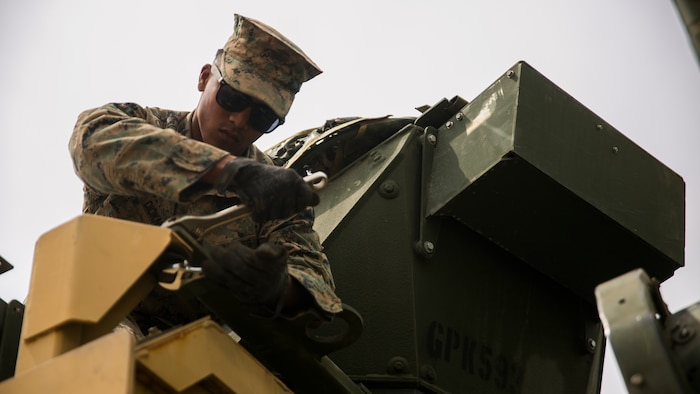 MARINE CORPS BASE CAMP PENDLETON, Calif. – Cpl. Marlon Diokno a motor transportation operator with Combat Logistics Battalion 15, 15th Marine Expeditionary Unit,   loosens a screw from a turret station during PHIBRON-MEU integrated training at Camp Pendleton, April 9, 2017. This first at-sea exercise provides the Marines the opportunity to practice integrating with their Navy counterparts to form an efficient team capable of accomplishing a range of missions around the globe. This Navy-Marine Corps team supports combatant commanders in maintaining regional maritime security and stability while providing offshore options to deter influence and win in an era of uncertainty. (U.S. Marine Corps photo by Cpl. Frank Cordoba)