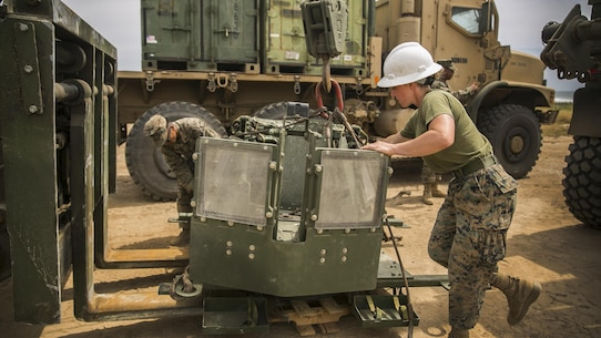 MARINE CORPS BASE CAMP PENDLETON, Calif. – Cpl. Madison Fitzgerald a motor transportation operator with Combat Logistics 15, 15th Marine Expeditionary Unit, adjusts a turret station into a vehicle during PHIBRON-MEU integrated training at Camp Pendleton, April 9, 2017. This first at-sea exercise provides the Marines the opportunity to practice integrating with their Navy counterparts to form an efficient team capable of accomplishing a range of missions around the globe. This Navy-Marine Corps team supports combatant commanders in maintaining regional maritime security and stability while providing offshore options to deter influence and win in an era of uncertainty. (U.S. Marine Corps photo by Cpl. Frank Cordoba)