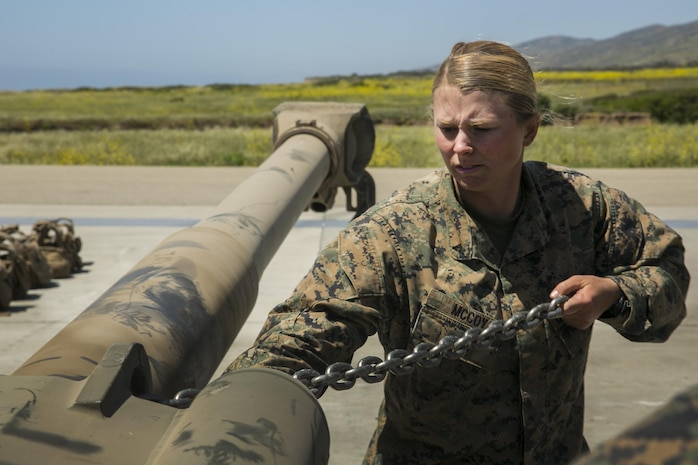 MARINE CORPS BASE CAMP PENDLETON, Calif. – Lance Cpl. Caitlin Mccoy a landing support specialist with Combat Logistics Battalion 15, 15th Marine Expeditionary Unit, secures chains to a M777 howitzer during phibron meu integrated training at Camp Pendleton, April 12, 2017. PMINT lays the foundation for all the elements of the MEU to develop relationships with their Navy counterparts and gain an understanding of the teamwork required to accomplish the mission. (U.S. Marine Corps photo by Cpl. Frank Cordoba)