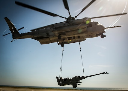 MARINE CORPS BASE CAMP PENDLETON, Calif. – A CH53E Super Stallion helicopter lifts a M777 howitzer during PHIBRON-MEU integration training at Camp Pendleton, April 12, 2017. The CH-53E Super Stallion makes the MEU that much more capable as it is able to move personnel, equipment, and vehicles from ship to shore, demonstrating the 15th MEU's ship-to-shore connector capabilities. PMINT lays the foundation for all the elements of the MEU to develop relationships with their Navy counterparts and gain an understanding of the teamwork required to accomplish the mission. (U.S. Marine Corps photo by Cpl. Frank Cordoba)